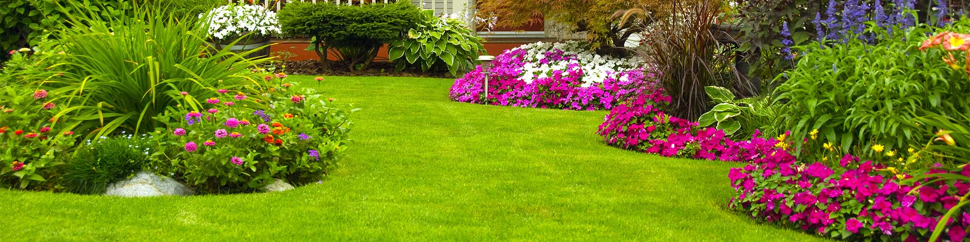 Landscaped Yard With Flowers and Bushes